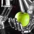 Robot hand holding green apple — Stock Photo