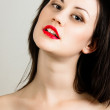 Stock Photo: Oung fashion model with white skin and red lipstick