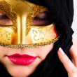 Carnival mask on a young attractive girl against white backgroun — Stock Photo #8085209