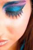 Closeup photo of a girl with beautiful makeup and selected focus — Stock Photo