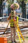 Worker inspecting site with his tripod and industrial device — Stock Photo