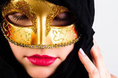 Carnival mask on a young attractive girl against white backgroun — Stock Photo