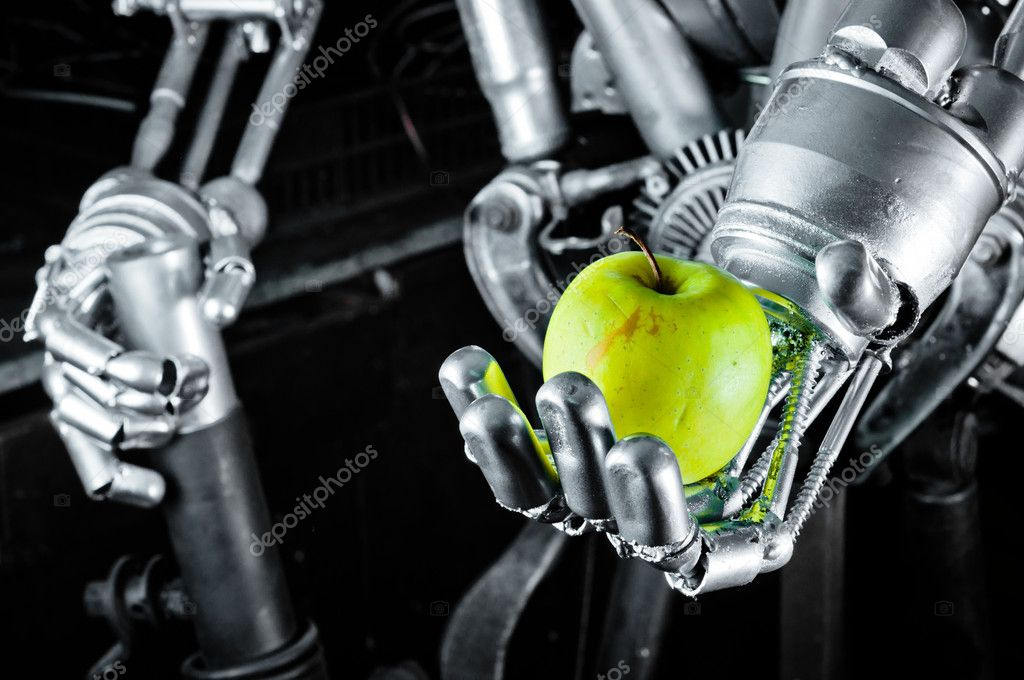 Green apple in the hands of a robot  Stock Photo #8084974