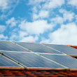Stock Photo: Cells of solar energy panels on roof of building