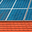 Cells of solar energy panels on the roof of a building — Stock Photo