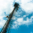 Steel radio tower against blue sky — Stock Photo #8799715