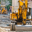 Big excavators at urban construction site — Stock Photo #8799927