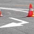 Road block with white arrow showing the alternate way — Stock Photo