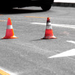 Stock Photo: Road block with white arrow showing the alternate way