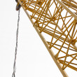 Industrial crane against white isolated background - Stock Photo