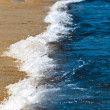 Stock Photo: Blue waves reaching shores of beach