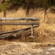 A damaged bench in the park — Stock Photo