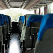 Interior of a bus with many seats — Stock Photo
