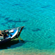 Small boat on the shore - Stok fotoğraf