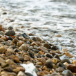 Rocks on the shore of an ocean - Stock Photo