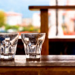 Постер, плакат: Coctail glass on the bar at a beach club
