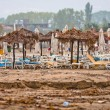 A dirty polluted beach  in the rain - Foto Stock
