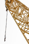 Industrial crane against white isolated background — Stock Photo
