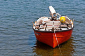 Small boat on blue water — Stock Photo