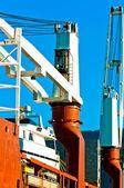 Industrial crane at dock — Stock Photo