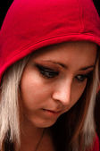 Attractive young woman in red hood — Stock Photo