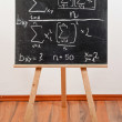 Black chalkboard with formula - Stock Photo
