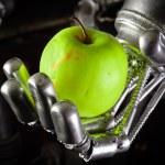 A robot hand holding a fresh apple — Stock Photo