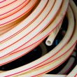 White plastic pipes in a stack — Stock fotografie