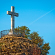 Stone cross at the top of a mountain — Stock Photo #9272542