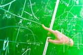 Green chalk board with formulas — Stock Photo