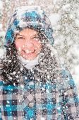 Out of focus picture of a woman with a lot of snowflakes — Stock Photo