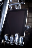 Robot hand holding tablet pc — Stock Photo