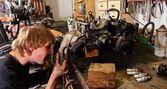Worker Repairing car motor — Stock Photo