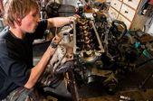 Mechanic worker inspecting car interiors — Stock Photo