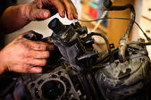 Worker repairing mechanical component — Stock Photo
