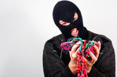Thief in mask holding expensive goods — Stock Photo