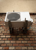 Air conditioner on brick wall — Stock Photo