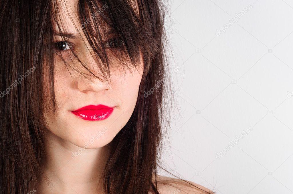 一个女人和鲜红的嘴唇特写照片