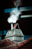 Small chimney with smoke — Stock Photo