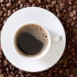 Coffee beans, white little cup — Stockfoto