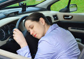Young girl sleeps in her car. — Stock Photo