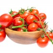 The branch of cherry tomatoes in a wooden bowl, isolated on whit — Stock Photo #10667188