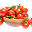 The branch of cherry tomatoes in a wooden bowl, isolated on whit — Stock Photo