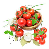 The branch of cherry tomatoes in a wooden bowl, onion, garlic, b — Stock Photo