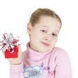 Girl in christmas hat withbig red gift box isolated on white. — Stock Photo
