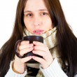 Young woman caught cold, wrapped up in blanket, drinking somethi — Stock Photo