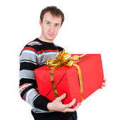 A man holding a big gift isolated on white background — Stock Photo