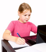 The schoolgirl does homework isolated — Stock Photo