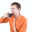 Royalty-Free Stock Photo: Young man drinking coffee on a white.