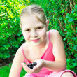 Young girl is picking black currant. — Stock Photo